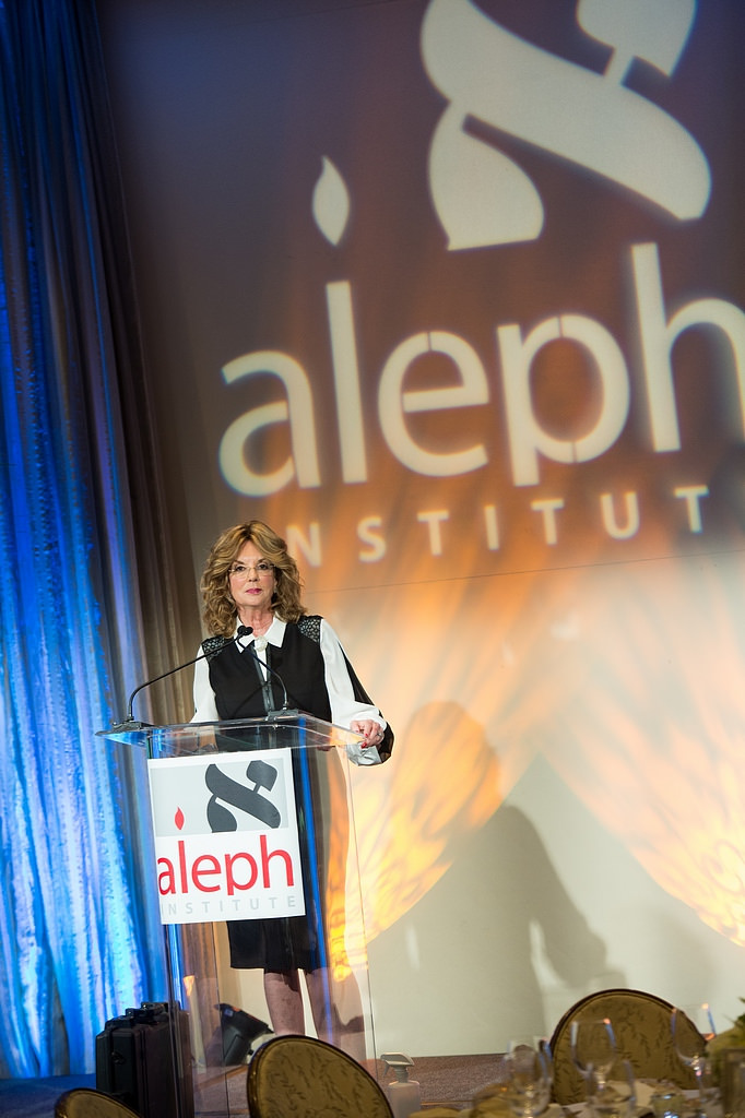 Sarah Weintraub at the Aleph Institute Gala podium at the Four Seasons Beverly Hills
